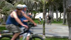 Riding bicycles in Venice Beach, California, BlackMagic 4K Production Camera Stock Footage