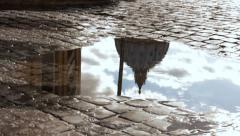 St Peter's Dome, Vatican reflected in a puddle - stock footage