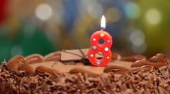 8th birthday cake and candle Stock Footage