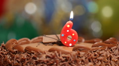 Red  Birthday Candle being blown out Stock Footage