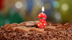 Birthday cake for a 3rd birthday - stock footage