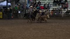 Rodeo night rain storm steer wrestling HD 279 Stock Footage