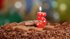 Birthday cake with a number 5 candle - stock footage
