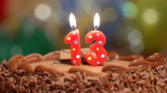 Candles for 13th birthday blown out - stock footage