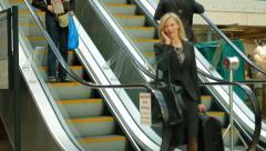 Business traveller - escalator phone call Stock Footage