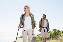 Stock Photo of Attractvie hiking couple walking on mountain trail