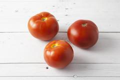 tomatoes on a white table - stock photo