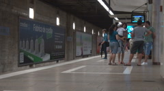Subway at the interior, people waiting relaxed the metro train, modern travel Stock Footage