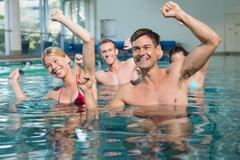 Fitness class doing aqua aerobics Stock Photos