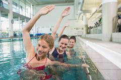 Stock Photo of Female fitness class doing aqua aerobics