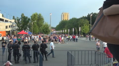 Football fans hurry to stadium, policemen ready for intervention supporters seen - stock footage