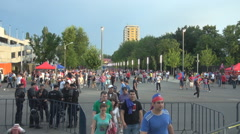People football fans on stairs to arena, big event cup match, policemen guarding Stock Footage