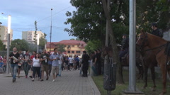 Big football match view, crowded street by fans, policemen ensuring protection - stock footage