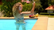 Stock Video Footage of Beautiful Curly Woman Making Selfie in the Swimming Pool.