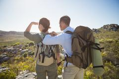 Stock Photo of Hiking couple looking out over country terrain