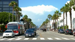 Public bus on Wilshire Boulevard in Santa Monica, Los Angeles, BlackMagic Camera Stock Footage