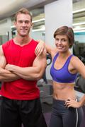 Stock Photo of Fit attractive couple smiling at camera
