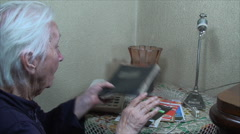 98 Years Old Woman, Going Through Address Book, Communication, Elderly, Phone - stock footage