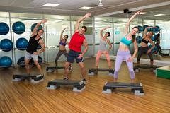 Stock Photo of Fitness class doing step aerobics