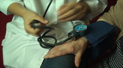 Medical Student Practicing On Her Great Great Grandmother, Blood Pressure Detail Stock Footage