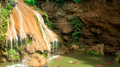 HD time lapse waterfall with people playing water zoom out wide Stock Footage