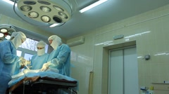 Operation: three surgeons and an anesthesiologist on oncological surgery Stock Footage