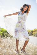 Stock Photo of Beautiful woman in floral dress smiling at camera