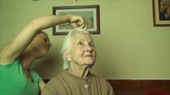 Grand Grand Daughter Combing Her 98 Years Old Grand Grand Mother Hair, Pan Stock Footage