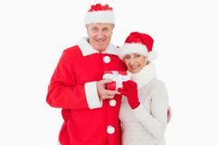 Stock Photo of Festive couple smiling and holding gift