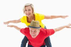 Mature couple joking about together Stock Photos