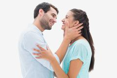 Attractive young couple about to kiss - stock photo