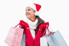 Stock Photo of Beautiful festive woman holding shopping bags