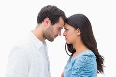 Angry couple staring at each other - stock photo