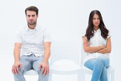 Angry couple not talking after argument - stock photo