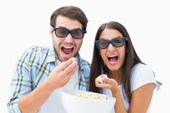 Attractive young couple watching a 3d movie - stock photo