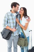 Attractive young couple going on their holidays - stock photo