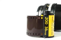 the film strip with camera lens - stock photo