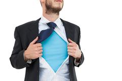 Geeky hipster opening shirt superhero style Stock Photos