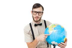 Stock Photo of Geeky hipster holding a globe