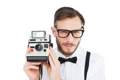 Stock Photo of Geeky hipster holding a retro camera