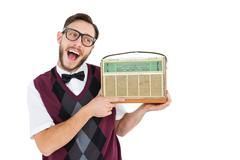 Stock Photo of Geeky hipster holding a retro radio