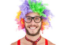 Geeky hipster in afro rainbow wig Stock Photos