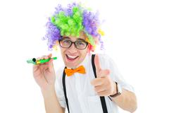 Geeky hipster in afro rainbow wig - stock photo