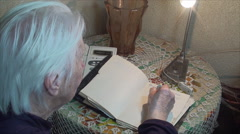 98 Years Old Woman Writing A Phone Number In Address Book, Back Shot Stock Footage