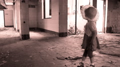 Abandoned little girl in ruined house Stock Footage