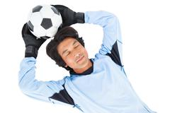 Stock Photo of Goalkeeper in blue holding ball