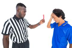 Stock Photo of Serious referee showing red card to player