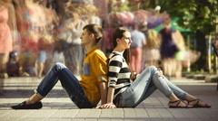 4K & HD resolutions, TIME-LAPSE: Lovers sitting on the sidewalk in the crowd - stock footage