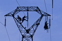 Workers on pylon, Brittany, France, Europe Stock Photos