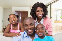 Happy family relaxing on the couch - stock photo
